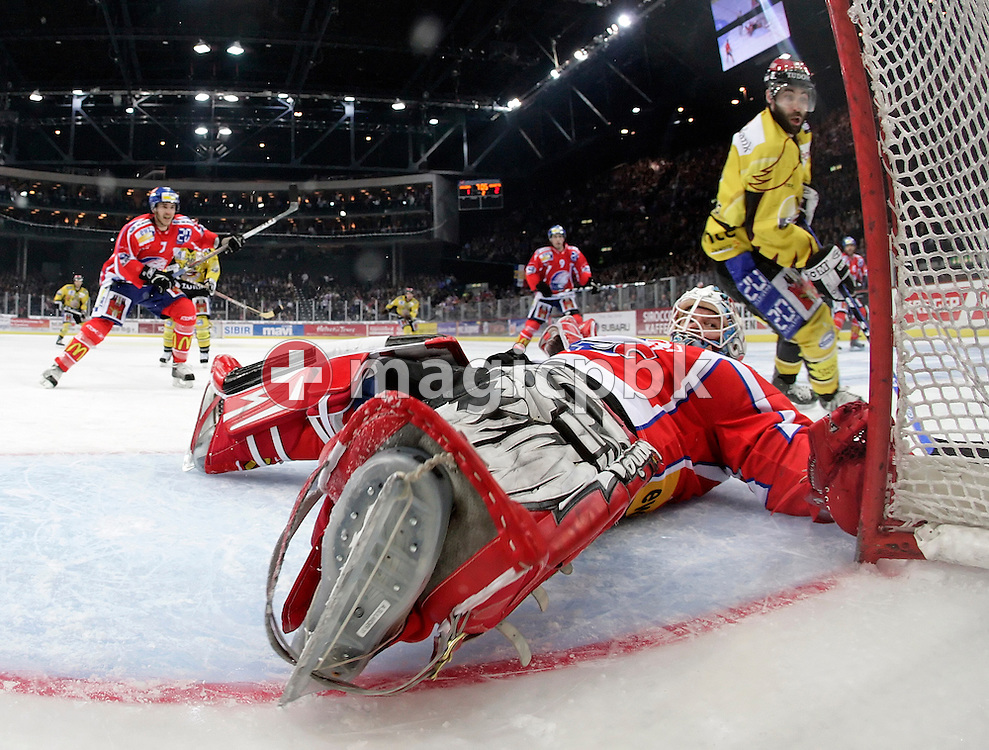 Goaltender Ari Sulander (C) of the ZSC Lions lies on his back after making a save against Geneva's Laurent Meunier (R) during the Swiss NHL Play-Off final ice hockey game between ZSC Lions and Geneve-Servette HC held at the Hallenstadion in Zuerich, Switzerland, Monday, March 31, 2008. Geneve-Servette HC wins 4:2 and leads the best of 7 series 2:0. (Photo by Patrick B. Kraemer / MAGICPBK)