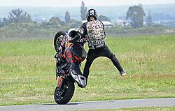 A trick motorcyclist displays his skills at the Tauranga City Airshow, Tauranga, New Zealand, Saturday, January 20,  2018. Credit:SNPA / Richard Moore **NO ARCHINVING**