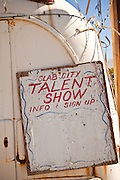 Talent show sign decorates public space in the Slab City commune camp Niland, California