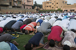 Image ©Licensed to i-Images Picture Agency. 28/07/2014. Cairo, Egypt. <br /> 61981786<br /> Egyptians take part in a morning prayer in a public field in Cairo, capital of Egypt, July 28, 2014. Egyptians celebrated the Eid al-Fitr, which marks the end of holy month of Ramadan during which Muslims all over the world fast from sunrise to sunset. Picture by  imago / i-Images<br /> UK ONLY
