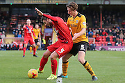 York City midfielder James Berrett  shields the ball from Newport County defender, on loan from Preston North End, Ben Davies  during the Sky Bet League 2 match between York City and Newport County at Bootham Crescent, York, England on 16 January 2016. Photo by Simon Davies.