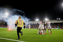 LONDON, ENGLAND - Monday, August 20, 2018: Liverpool's Sadio Mane celebrates scoring the second goal, in the 93rd minute to seal a 2-0 victory, with team-mates as a flare is thrown onto the pitch during the FA Premier League match between Crystal Palace and Liverpool FC at Selhurst Park. (Pic by David Rawcliffe/Propaganda)