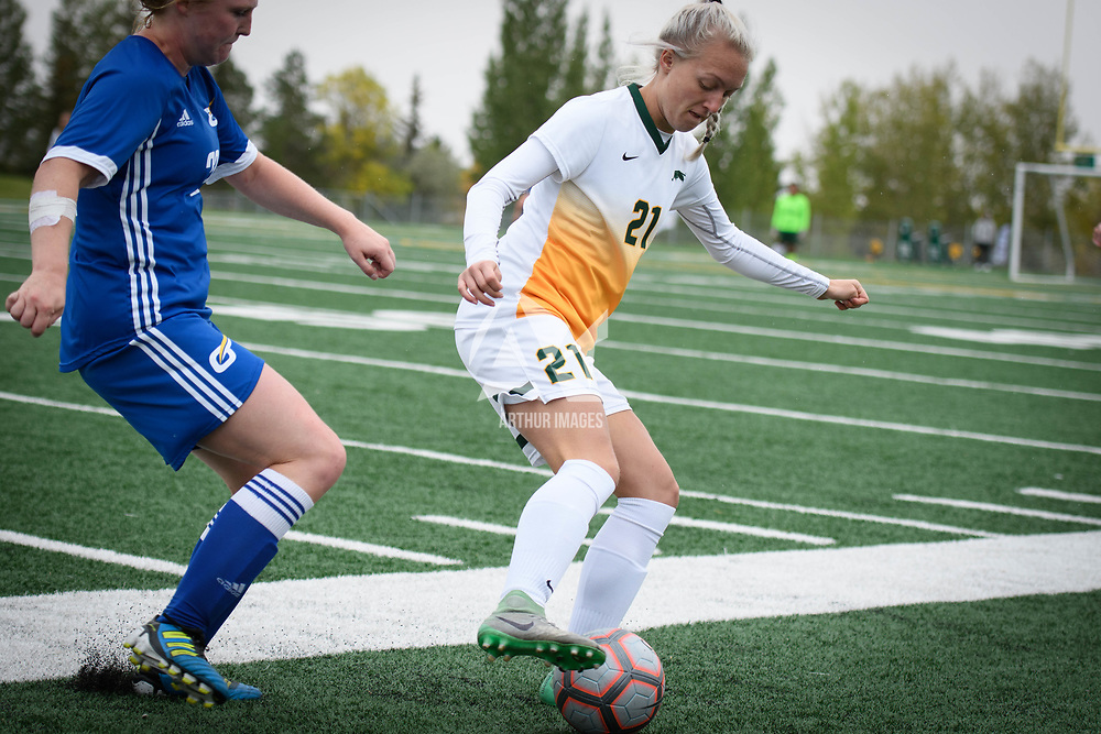 1st year Sally Bachmann (21) of the Regina Cougars during the Women's Soccer Homeopener on September 16 at U of R Field. Credit: Arthur Ward/Arthur Images