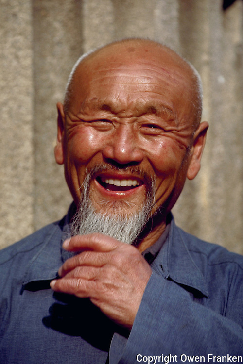 April 1985, China --- Portrait of Laughing Chinese Man --- Image by © Owen Franken/CORBIS