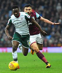 Andy Yiadom of Barnsley tries to hold off Robert Snodgrass of Aston Villa-Mandatory by-line: Nizaam Jones/JMP - 20/01/2018 - FOOTBALL - Villa Park - Birmingham, England - Aston Villa v Barnsley- Sky Bet Championship