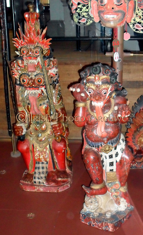Brahma in a demonic form. Balinese (Indonesia) Hindu carving in wood. Early 20th Century. (left). Buta, a demon in Hindu mythology. Red symbolises anger and lust.