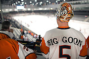 "David Faas, commonly known as ""The Big Goon,"" watches an exhibition game between the RIT Women's Hockey team and Pursuit of Excellence, a junior team from British Columbia, the first game at RIT's Gene Polisseni Center on Monday, September 29, 2014."