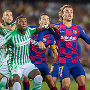 BARCELONA, SPAIN - August 25:  Antoine Griezmann #17 of Barcelona defended by Emerson #22 of Real Betis at a corner kick during the Barcelona V  Real Betis, La Liga regular season match at  Estadio Camp Nou on August 25th 2019 in Barcelona, Spain. (Photo by Tim Clayton/Corbis via Getty Images)