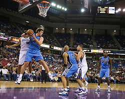 October 23, 2009; Sacramento, CA, USA;  Utah Jazz center Kyrylo Fesenko (44) grabs a rebound from Sacramento Kings forward Omri Casspi (18) during the fourth quarter at the ARCO Arena.  The Jazz won 95-85.