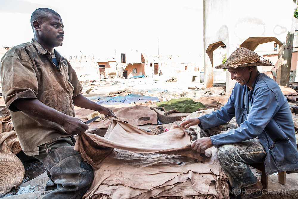Workers check the integrity of lambskins in a tannery in Marrakech