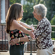 WASHINGTON,DC-AUG21: Sheila Thomas (left) and Kate Billingsley embrace after meeting for the first time, outside the Georgetown library, in Washington, DC, August 21, 2017. Sheila is presumed to be the great-great-great granddaughter of Roger B. Taney, the U.S. Supreme Court chief justice who said blacks had no rights and could not be U.S. citizens. Kate Billingsley is a descendant of Taney, her father is Charles Taney III, a distant nephew of Roger Brooke Taney.  Kate and Sheila would be distant cousins. (Photo by Evelyn Hockstein/For The Washington Post)