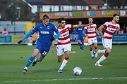 AFC Wimbledon attacker Marcus Forss (15) battles for possession with Doncaster Rovers defender Reece James (3) during the EFL Sky Bet League 1 match between AFC Wimbledon and Doncaster Rovers at the Cherry Red Records Stadium, Kingston, England on 14 December 2019.