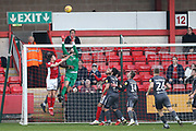 1 Josh Vickers saves for Lincoln City from 15 Ryan Wintle for Crewe Alexander during the EFL Sky Bet League 2 match between Crewe Alexandra and Lincoln City at Alexandra Stadium, Crewe, England on 26 December 2018.