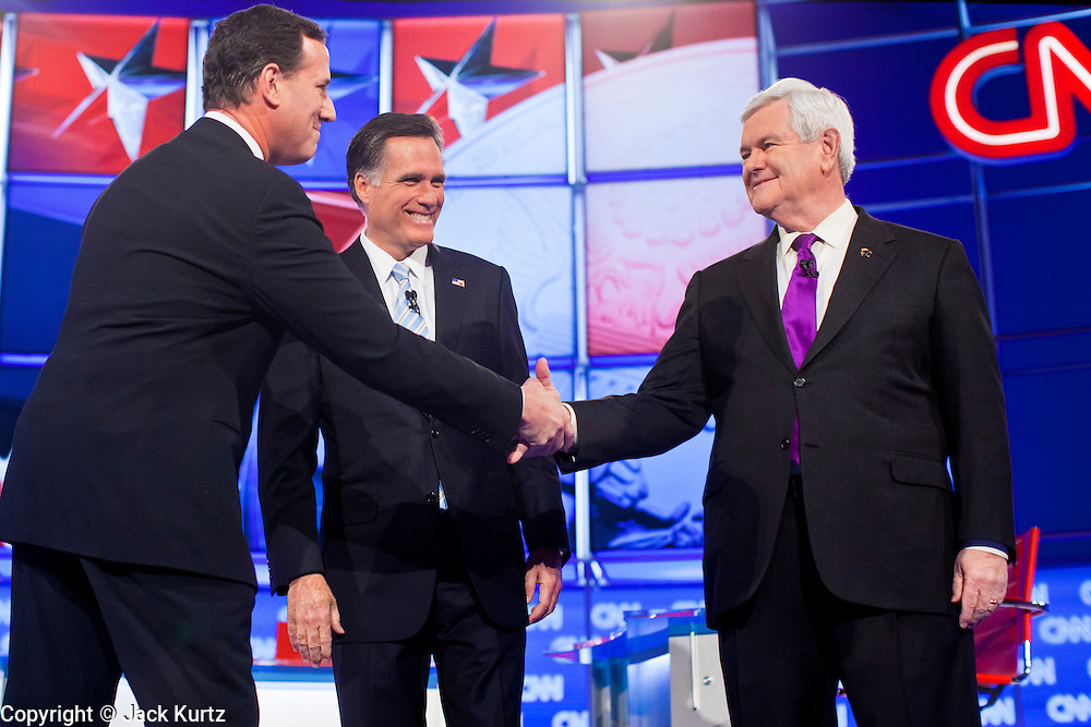 """22 FEBRUARY 2012 - MESA, AZ:   Senator RICK SANTORUM shakes hands with Governor MITT ROMNEY and Congressman NEWT GINGRICH at the Arizona Republican Presidential Debate in the Mesa Arts Center in Mesa, AZ, Wednesday. It is the last debate before the Michigan and Arizona Republican primaries on Feb. 28 and """"Super Tuesday"""" on March 6. PHOTO BY JACK KURTZ"""