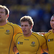 Australian players Rocky Elsom, (left) David Pocock, (centre) and Quade Cooper, (right) during the teams national anthems before the South Africa V Australia Quarter Final match at the IRB Rugby World Cup tournament. Wellington Regional Stadium, Wellington, New Zealand, 9th October 2011. Photo Tim Clayton...