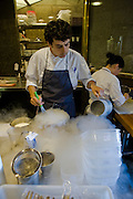 A chef cooks with liquid nitrogen at El Bulli restaurant near Rosas on the Costa Brava, northern Spain on the Mediterranean.
