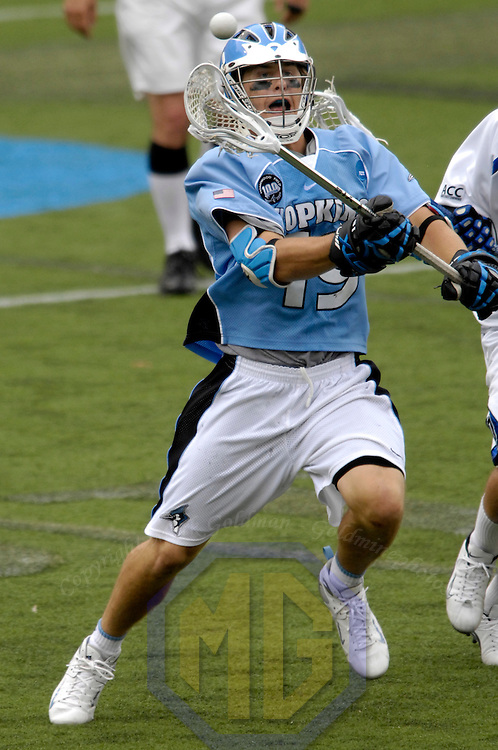 28 May 2007:  Johns Hopkins midfielder Brian Christopher (19) fights for a loose ball in the 4th quarter against the Duke University Blue Devils in the NCAA Division I Lacrosse Championship game.  The Johns Hopkins Blue Jays defeated the Duke Blue Devils 12-11 to win the NCAA Division I Lacrosse championship at M&T Bank Stadium in Baltimore, Md.