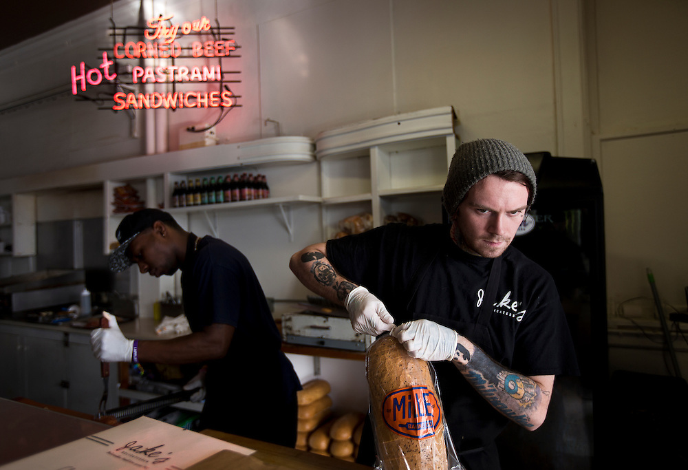 MILWAUKEE, WI - NOVEMBER 17: Line cook Ian Pfeiffer, 25, prepares a sandwich at Jake's Delicatessen on Thursday, November 17, 2016.