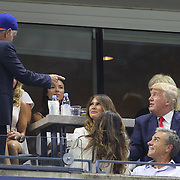 Donald Trump meets John McEnroe while watching Serena Williams, USA, in action against her sister Venus Williams, USA, in the  Women's Singles Quarterfinals match during the US Open Tennis Tournament, Flushing, New York, USA. 8th September 2015. Photo Tim Clayton