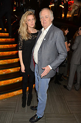 SIR TIM RICE and his daughter EVA RICE at the Costa Book of The Year Awards held at Quaglino's, 16 Bury Street, London on 26th January 2016.