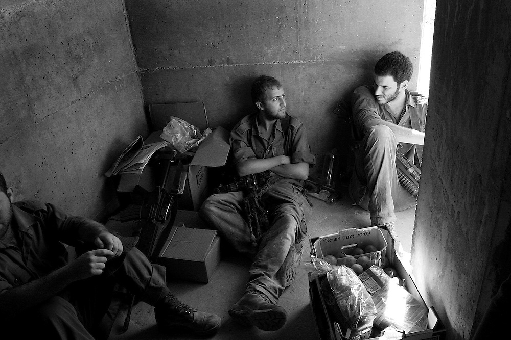Soldiers take cover in a bunker during a Hezbollah rocket attack in northern Israel. Aug 2006