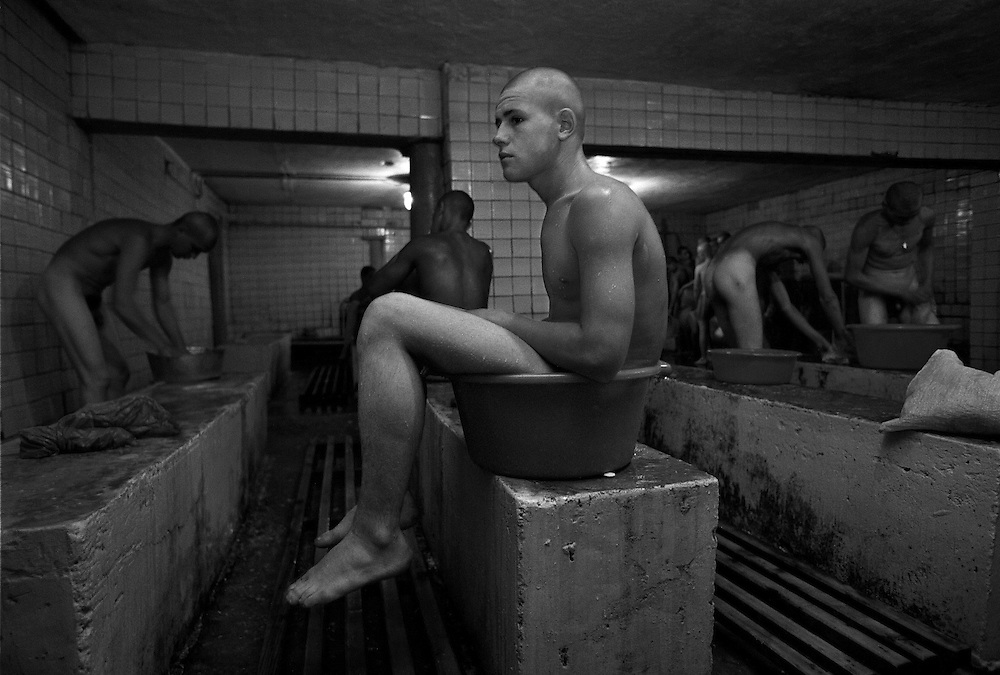 A prisoner's boy seats in a wash-basin in the bath-room at the colony for prisoner's children in Siberian town Leninsk-Kuznetsky, Russia, 15 January 2001.