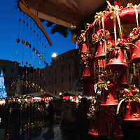 VERONA, ITALY - DECEMBER 04:  Christmas decorations and in the distance a Christmas tree at the Verona Christmas Marketin Piazza dei Signori on December 4, 2010 in Verona, Italy. Christmas markets, fairs, lights and nativity scenes fill Northern Italian cities and villages from December through January 6.