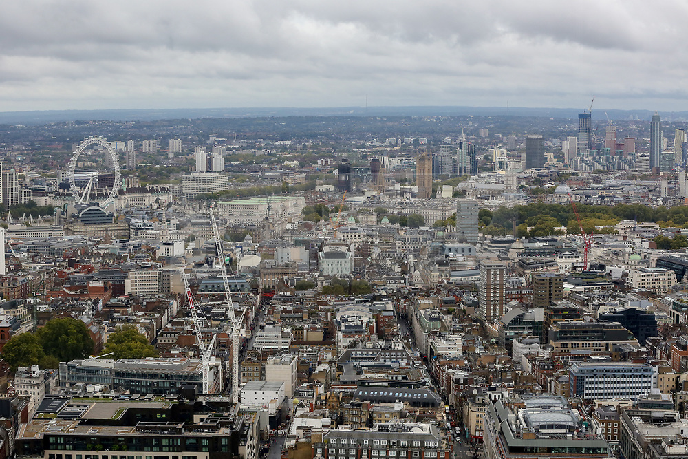 © Licensed to London News Pictures. 22/09/2019. London, UK. An aerial view of London showing London Eye, Big Ben, Houses of Parliament and the city of London on a cloudy day in the capital seen from BT Tower. Photo credit: Dinendra Haria/LNP