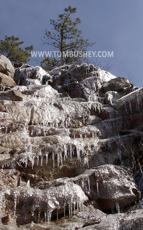 Cragsmoor, NY - Ice and icicles cover the rocks on a cliff on March 3, 2008.
