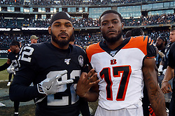 OAKLAND, CA - NOVEMBER 17: Defensive back Keisean Nixon #22 of the Oakland Raiders and wide receiver Stanley Morgan #17 of the Cincinnati Bengals stand on the field after the game at RingCentral Coliseum on November 17, 2019 in Oakland, California. The Oakland Raiders defeated the Cincinnati Bengals 17-10. (Photo by Jason O. Watson/Getty Images) *** Local Caption *** Keisean Nixon; Stanley Morgan