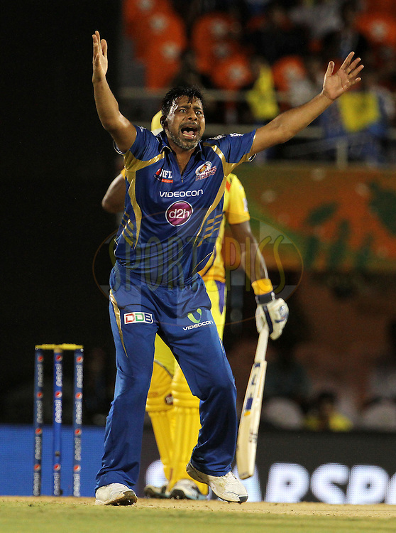 Praveen Kumar of the Mumbai Indians appeals unsuccessfully during the eliminator match of the Pepsi Indian Premier League Season 2014 between the Chennai Superkings and the Mumbai Indians held at the Brabourne Stadium, Mumbai, India on the 28th May  2014<br /> <br /> Photo by Vipin Pawar / IPL / SPORTZPICS<br /> <br /> <br /> <br /> Image use subject to terms and conditions which can be found here:  http://sportzpics.photoshelter.com/gallery/Pepsi-IPL-Image-terms-and-conditions/G00004VW1IVJ.gB0/C0000TScjhBM6ikg