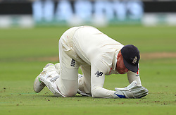 England wicketkeeper Jonny Bairstow lies injured during day three of the Specsavers Third Test match at Trent Bridge, Nottingham.