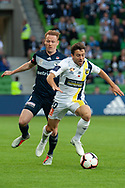 Melbourne Victory midfielder James Troisi (10) competes with Melbourne Victory defender Corey Brown (3) at the Hyundai A-League Round 4 soccer match between Melbourne Victory and Central Coast Mariners at AAMI Park in Melbourne.