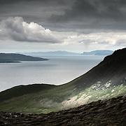 Rum and Skye from Dunan Thalasgair, Isle of Eigg.