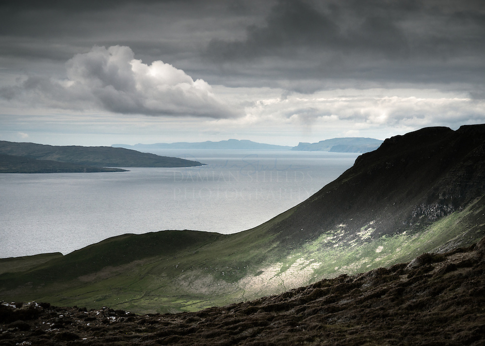 Rum and Skye from Dunan Thalasgair, Isle of Eigg.