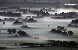 © Licensed to London News Pictures. 22/07/2017. Mist on the moors around Glastonbury Tor in Somerset at first light on Saturday, an area deluged by rain recently. Photo credit: Jason Bryant/LNP
