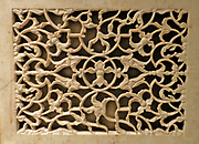 Panel.  Marble inlaid with yellow and black marble and cornelian, c1880 after a Mughal original of 1628.  The decoration on this panel was probably copies from a detail on the tomb of I' mad ad-Duala at Agra, completed in 1628.