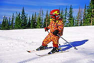 Child downhill skiing in winter. Silver Mountain Ski Area, Kellog, north Idaho.