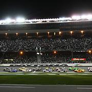 The opening lap of the NASCAR Sprint Unlimited Race at Daytona International Speedway on Saturday, February 15,  2014 in Daytona Beach, Florida.  (AP Photo/Alex Menendez)
