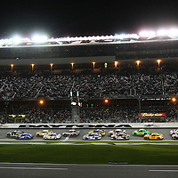 The opening lap of the NASCAR Sprint Unlimited Race at Daytona International Speedway on Saturday, February 15,  2014 in Daytona Beach, Florida.  (AP Photo/Alex Menendez)