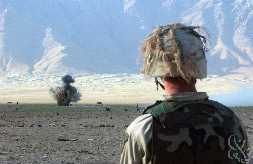 A soldier from the US Army 101st airborne watches a mortar round explode on the Shamali plain during a traning exercise on July 14, 2002 near Bagram in Afghanistan. Coalition forces continue to train for missions as part of the ongoing Operation Enduring Freedom.
