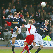 Dundee v Livingston<br /> Scottish League First Division<br /> Dens Park, Dundee<br /> 20/10/2007<br /> Dundee's Jan Zemlik (left) wins an aerial challenge with Livingston's Lee Makel (6) as team-mate Kevin McDonald looks on