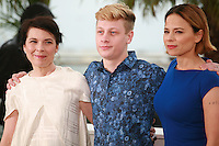 Anne Dorval, Antoine-Olivier Pilon and Suzanne Clément, at the photo call for the film Mommy at the 67th Cannes Film Festival, Thursday 22nd May 2014, Cannes, France.