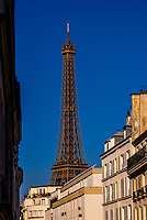 Daytime view on rue St. Dominque with the Eiffel Tower behind, Paris, France. It is the world famous wrought-iron lattice tower that is the most famous landmark of Paris, France.