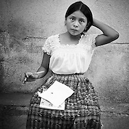 Young girl doing here homework out in the street of San Pedro by Lago de Atitlan in Guatemala