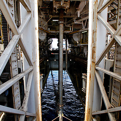A riser pipe that connects to the well head 5000 feet below the surface is seen from the moon pool on board the Transocean Development Driller II rig leased by BP Plc which is drilling a backup relief well at the BP Plc Macondo well site in the Gulf of Mexico off the coast of Louisiana, U.S., on Saturday, August 7, 2010. BP successfully used the 'static kill', procedure  pumping mud into the top of the damaged well, BP plans now to finish a relief well to permanently plug the well by mid-August. Photographer: Derick E. Hingle/Bloomberg