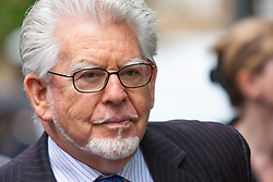 London, May 27th 2014. Entertainer and artist Rolf Harris arrives at Sothwark Crown Court in London as he prepares to begin his defence on 12 charges of indecent assault against four girls aged between 7 and 19.