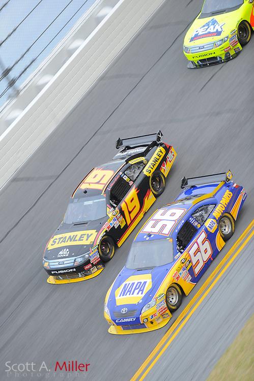 Feb. 11, 2010; Daytona Beach, FL, USA; NASCAR Sprint Cup Series drivers Elliott Sadler (19) and Martin Truex Jr. (56) in turn 4 during race two of the Gatorade Duel at Daytona International Speedway. ©2010 Scott A. Miller