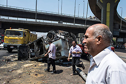 60360311 <br /> Photo taken on Thursday Aug. 15, 2013  shows a burned police vehicle in Cairo, Egypt. Egyptian authorities raised the death toll from clashes the previous day between police and supporters of the ousted Islamist president to 525 on Thursday. <br /> Picture by imago / i-Images<br /> UK ONLY