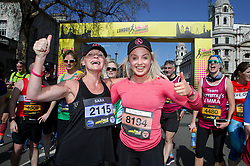 Competitor Aimee Fuller and her Mum cross the finish linne during the 2019 London Landmarks Half Marathon.